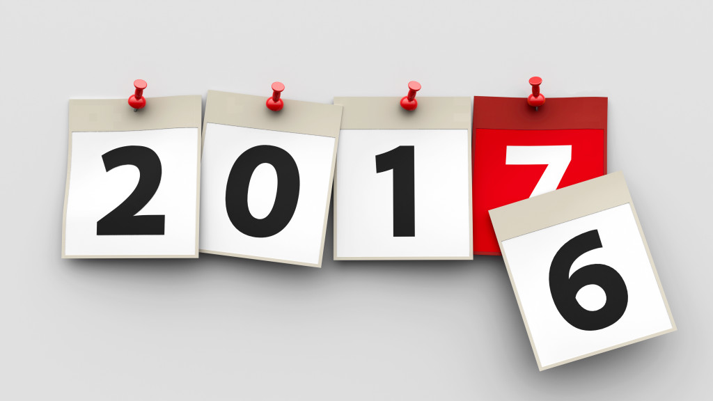 Calendar sheets with red pin and numbers 2017 on grey background represent start new year 2017, three-dimensional rendering, 3D illustration